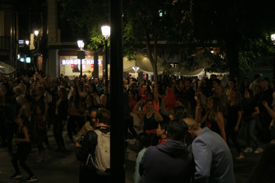 This was some weird dance that everybody knew the moves to except me. The entire plaza was full of people doing this same dance.